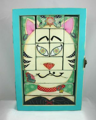 Puzzeled cat crop by dana newsom and janet hines